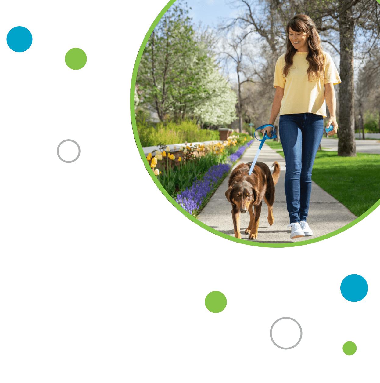 Portrait of woman walking her dog